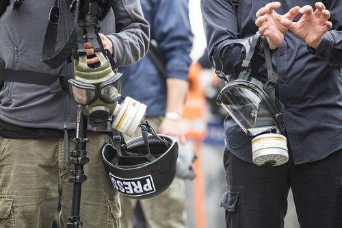 press  journalist  gas mask attack