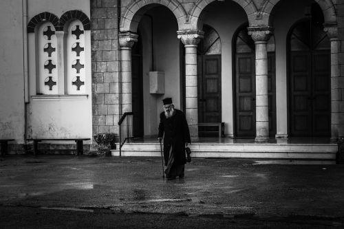 priest old man walking