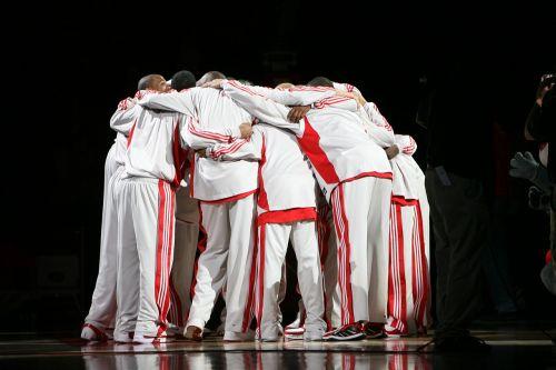 pro basketball team huddle basketball players