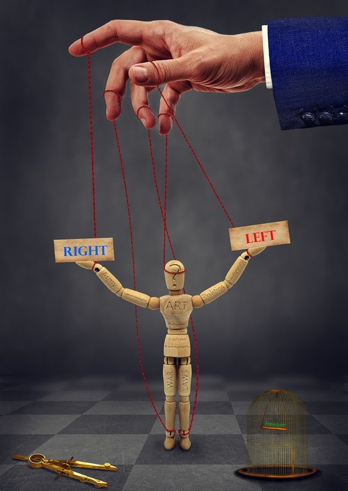 puppet  political  cage