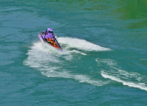 purple jet boat spinning waves