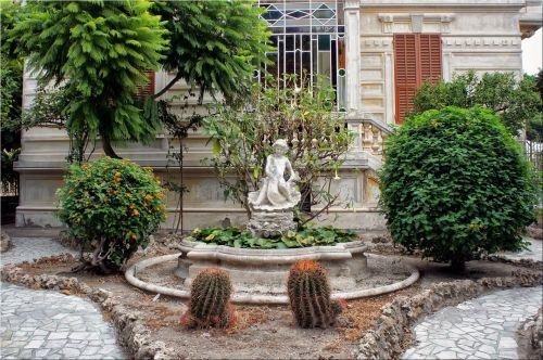 Putto In The Garden