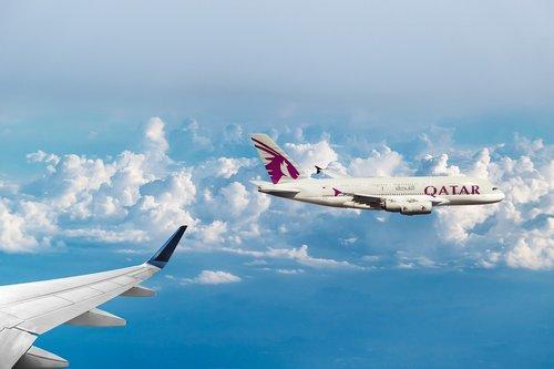 qatar airways  clouds  flying