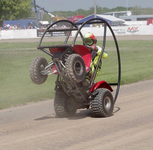 quad bike  stunt  wheelie