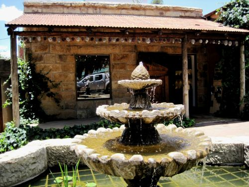 Quaint Shop And Fountain