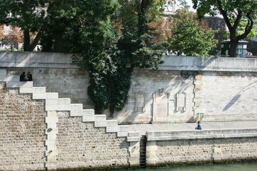 quay of the river seine paris steps