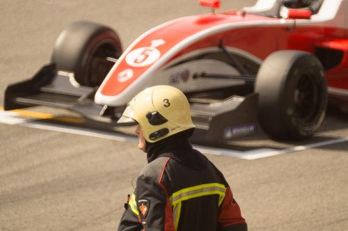 race car formula one fireman