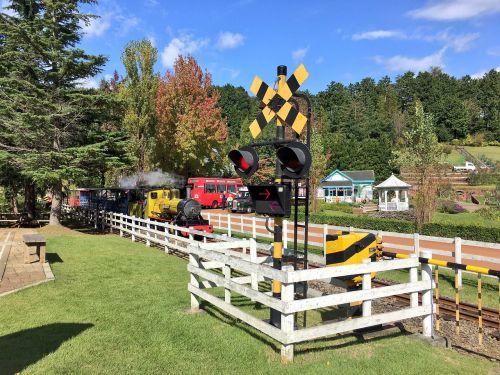 railroad crossing locomotive landscape