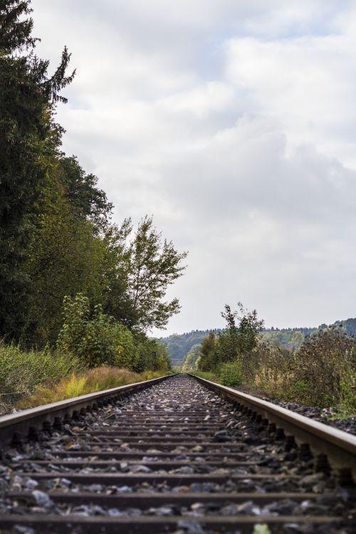 railway rails railway tracks railroad tracks
