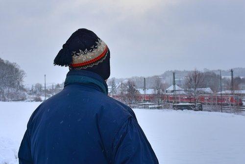railway station  winter  man