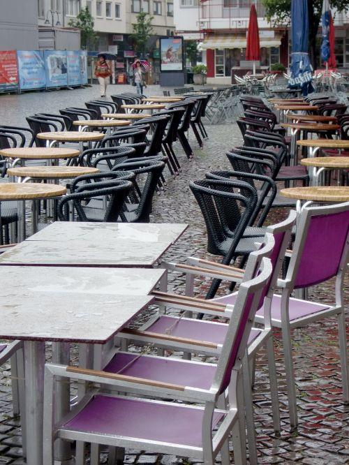 rain chairs street cafe