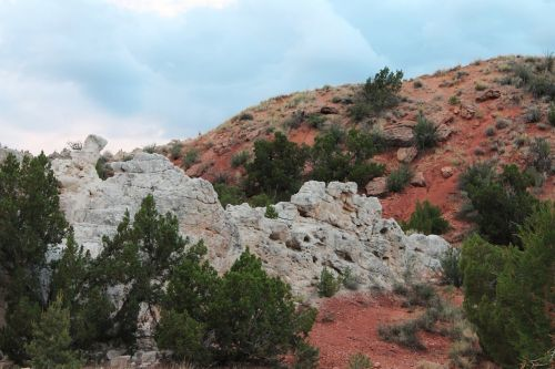 rain clouds storm red rock