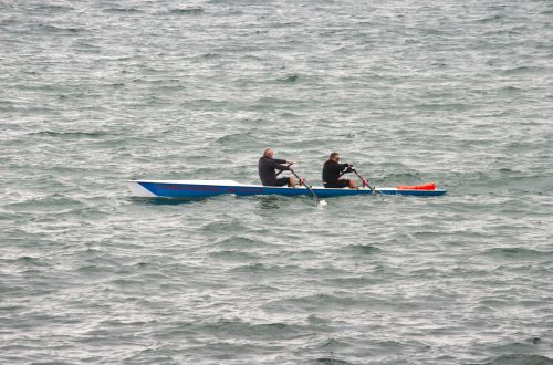 Rowers At Sea