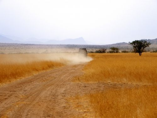 Range Rover Driving On Dusty Road