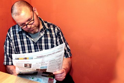 read newspaper newspaper man