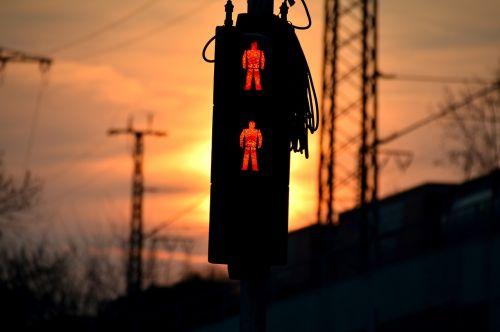 red traffic lights sunset