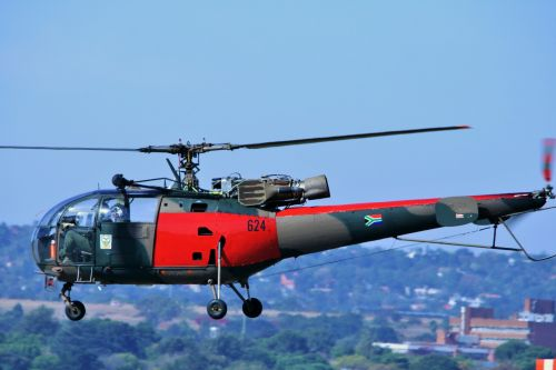 Red & Camo Alouette Iii Taking Off