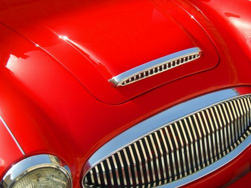 red car sports car hood
