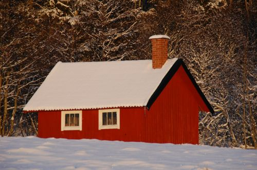red cottage cottage snow