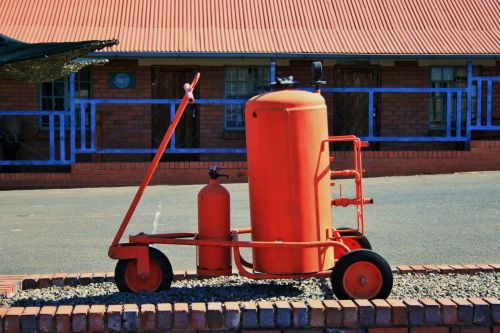 Red Fire Extinguisher On Wheels