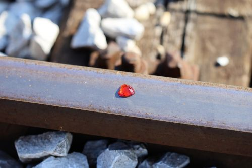 red heart on railway stop children suicide stop teenager suicide