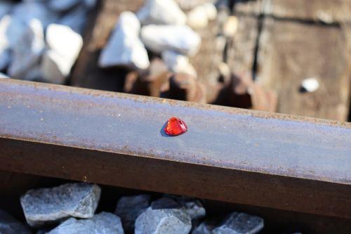 red heart on railway stop children suicide stop teenager suicide