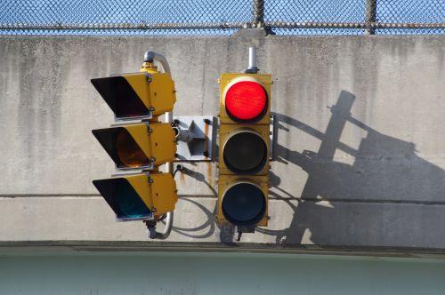 red light stoplight street sign
