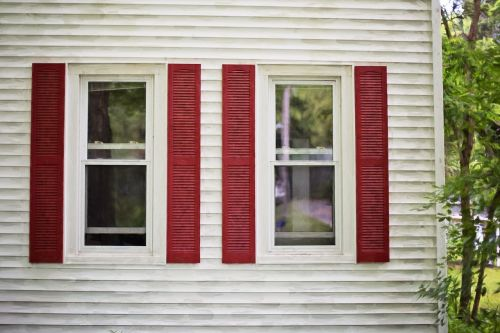 red shutters white house wooden