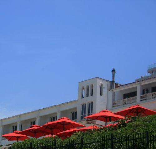 Red Umbrellas At Resort
