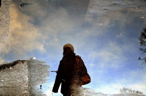 Reflection Of Women In Water