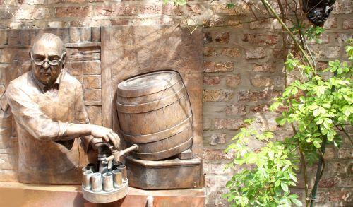 relief bronze beer keg