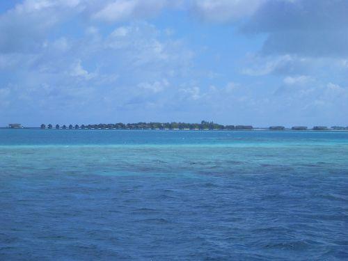 resort blue sea clouds