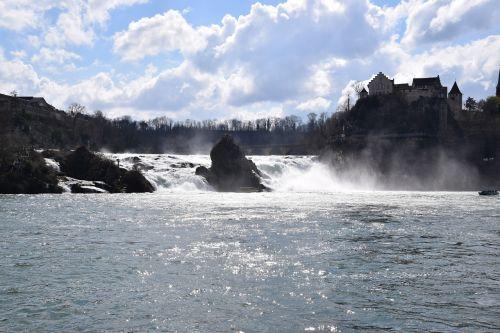 rhine falls waterfall back light