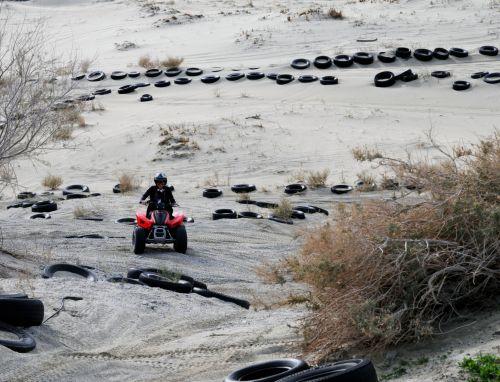 Riding An ATV In The Desert