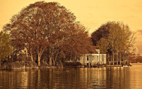 river farmhouse trees