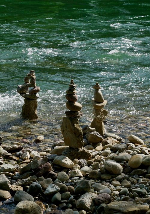 river stones cairn
