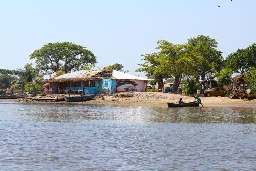 river scene gambia fishing village