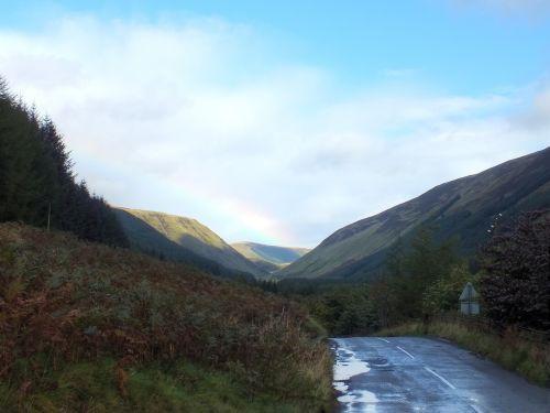 road rain rainbow