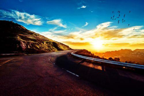 road mountain sunset