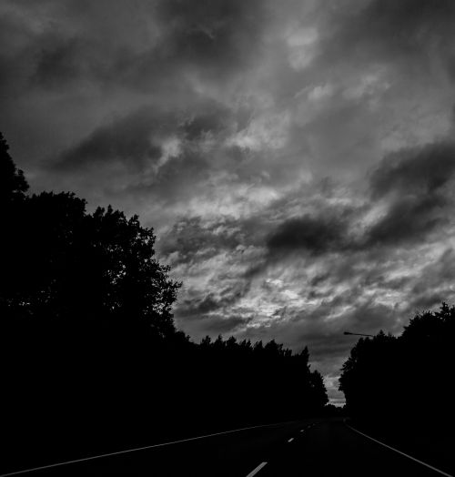 road black and white evening