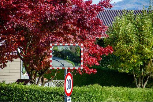 road mirror street sign traffic mirror