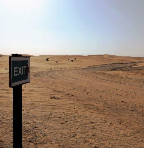 road sign desert sand