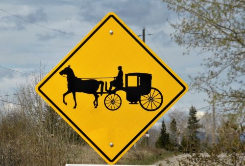 road sign coach horse and carriage