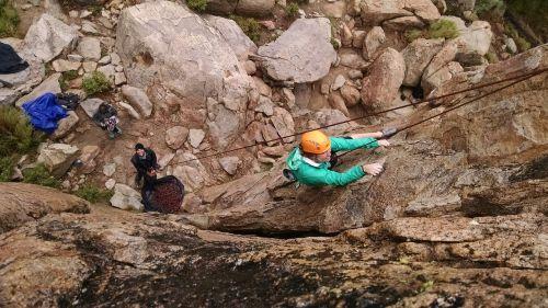 rock climbing female teamwork
