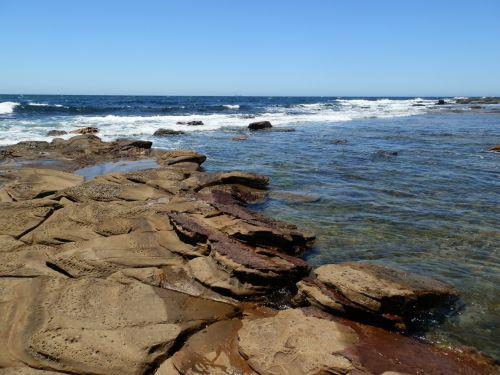 Rock Pool And Sea