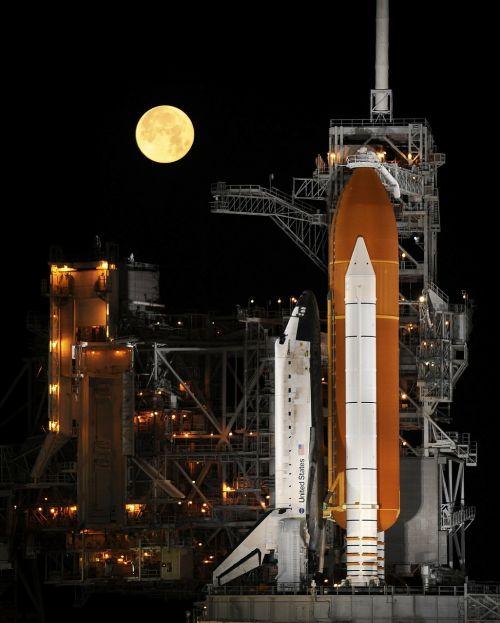 rocket launch night space shuttle
