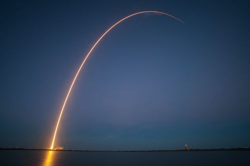 rocket launch night trajectory