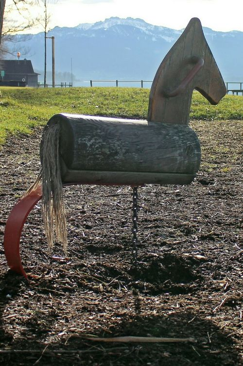 rocking horse swing rock