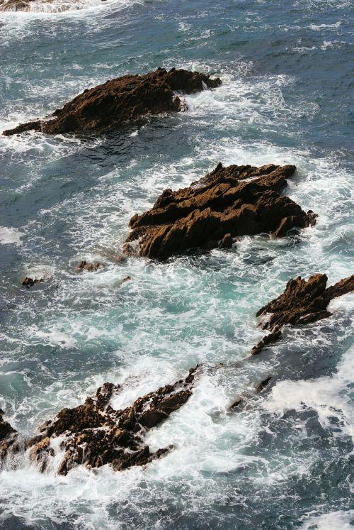 rocks sea crashing waves