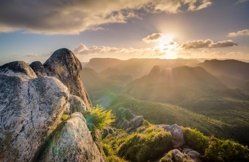 rocks,mountain,range,highlands,top,peak,summit,round,shape,stone,erosion,geology,formation,granite,view,panorama,vegetation,sunset,rays,light,free photos,free images,royalty free